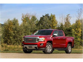 a red car parked on the side of a road: 2018 GMC Canyon