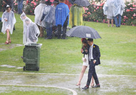 A general view is seen as racegoers walk in puddles as rain tumbles down after race 1 the Ottawa Stakes during Melbourne Cup Day at Flemington Racecourse on November 6, 2018 in Melbourne, Australia.