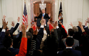 Reporters raise their hands to ask U.S.  President Donald Trump questions at a news conference following Tuesday's midterm congressional elections at the White House in Washington, U.S., November 7, 2018. REUTERS/Kevin Lamarque