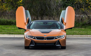 a car parked on the side of a road: 2019 BMW i8 Roadster