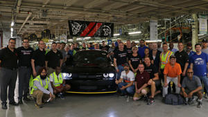 a group of people posing for the camera: Final 2018 Dodge Challenger SRT Demon