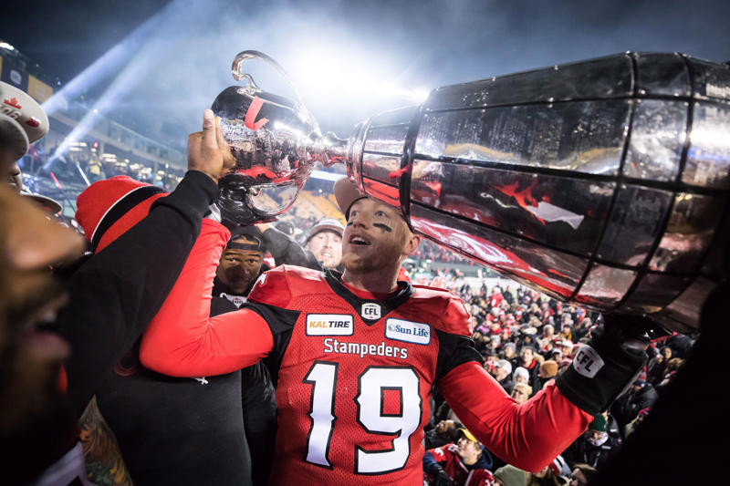 algary Stampeders quarterback Bo Levi Mitchell hoists the Grey Cup after defeating the Ottawa Redblacks in the 106th Grey Cup.