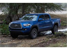 a blue car parked in a field: 2018 Toyota Tacoma