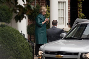 FILE: Democratic presidential candidate Hillary Clinton uses a smartphone as she leaves her home in Washington, Wednesday, Oct. 5, 2016, to attend a fundraiser downtown. (AP Photo/Andrew Harnik)
