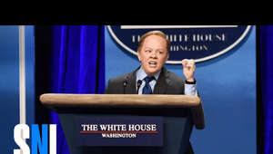 a screen shot of a man in a suit and tie: White House press secretary Sean Spicer (Melissa McCarthy) and secretary of education nominee Betsy DeVos (Kate McKinnon) take questions from the press (Bobby Moynihan, Kristen Stewart, Cecily Strong, Vanessa Bayer, Alex Moffat, Mikey Day).  Subscribe to SNL: https://goo.gl/tUsXwM  Get more SNL: http://www.nbc.com/saturday-night-live Full Episodes: http://www.nbc.com/saturday-night-liv...  Like SNL: https://www.facebook.com/snl Follow SNL: https://twitter.com/nbcsnl SNL Tumblr: http://nbcsnl.tumblr.com/ SNL Instagram: http://instagram.com/nbcsnl SNL Pinterest: http://www.pinterest.com/nbcsnl/