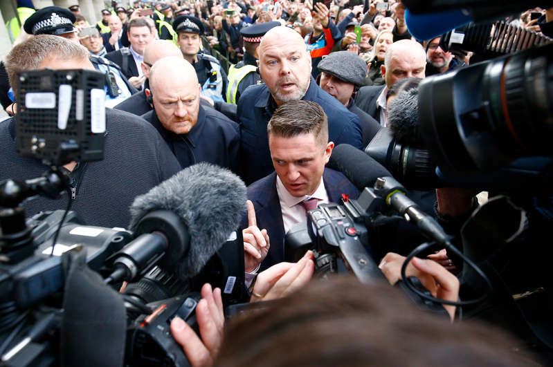 Far right activist Stephen Yaxley-Lennon, who goes by the name Tommy Robinson, leaves the Old Bailey after his contempt of court charge was referred to the Attorney General, in London, Britain, October 23, 2018. REUTERS/Henry Nicholls