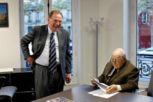Jean Jacques Bauer, who recovered a valuable Pissarro painting, right, and his lawyer Cedric Fischer, talk after an interview with Associated Press, in Paris, Tuesday, Nov. 7, 2017 (AP Photo/Thibault Camus)
