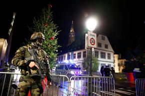 Soldier secures area where a suspect is sought after a shooting in Strasbourg, France, December 11, 2018.   REUTERS/Christian Hartmann