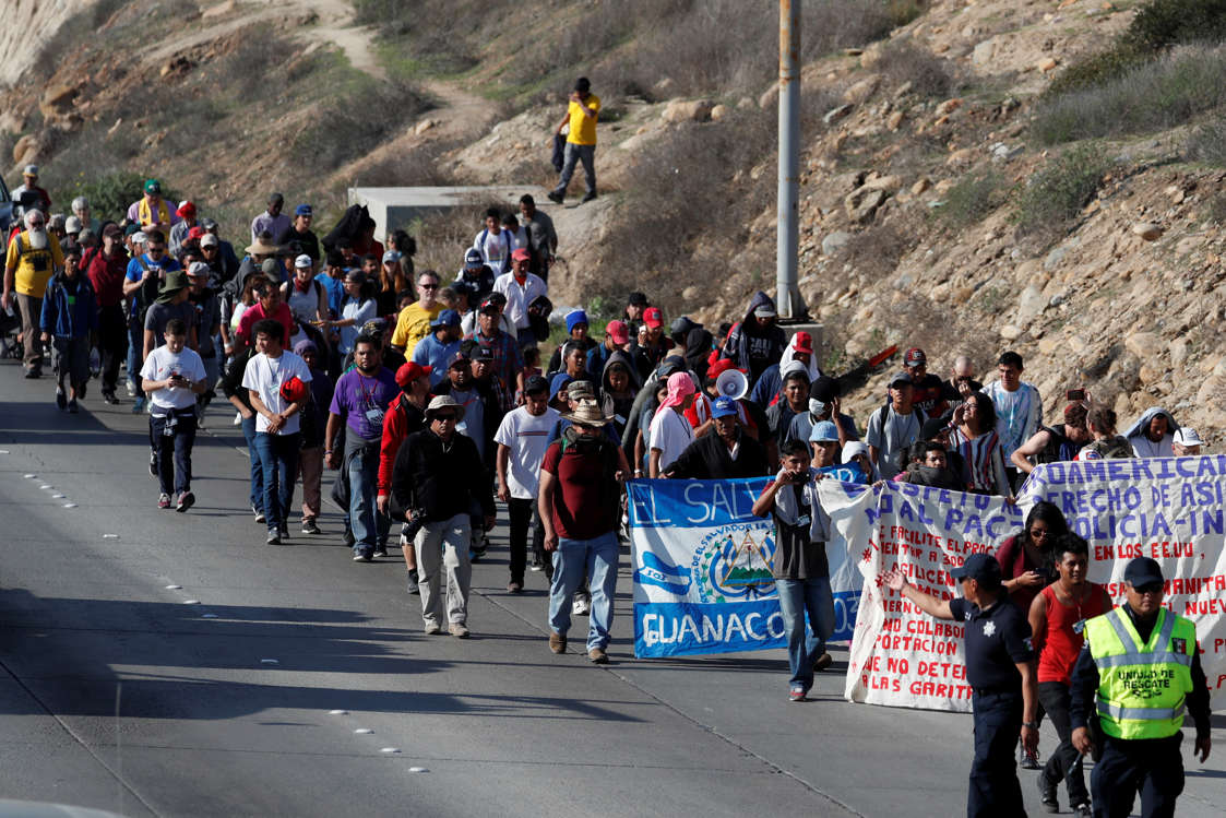 Migrants, part of a caravan of thousands from Central America trying to reach the United States, walk towards the U.S. Consulate during a demonstration in Tijuana, Mexico, December 11, 2018.