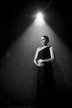 LONDON, ENGLAND - DECEMBER 10: (EDITORS NOTE: Image has been converted to black and white)  Meghan, Duchess of Sussex on stage during The Fashion Awards 2018 In Partnership With Swarovski at Royal Albert Hall on December 10, 2018 in London, England (Photo by Tristan Fewings/BFC/Getty Images)