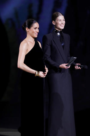 LONDON, ENGLAND - DECEMBER 10:  Meghan, Duchess of Sussex and Rosamund Pike on stage during The Fashion Awards 2018 In Partnership With Swarovski at Royal Albert Hall on December 10, 2018 in London, England.  (Photo by John Phillips/BFC/Getty Images)