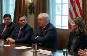 U.S. President Donald Trump (2nd R) meets with new U.S. governors-elect in the Cabinet Room of the White House in Washington, U.S., December 13, 2018. They are (L-R) Illinois' J.B. Pritzker, Florida's Ron DeSantis, and South Dakota's Kristi Noem.   REUTERS/Jim Young