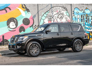 a car parked in a parking lot painted with graffiti: 2019 Nissan Armada