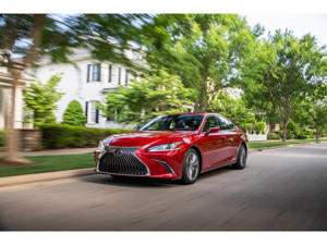 a red car parked on the side of a road: 2019 Lexus ES Hybrid