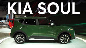 a green truck parked in front of a car: 2018 LA Auto Show: 2020 Kia Soul