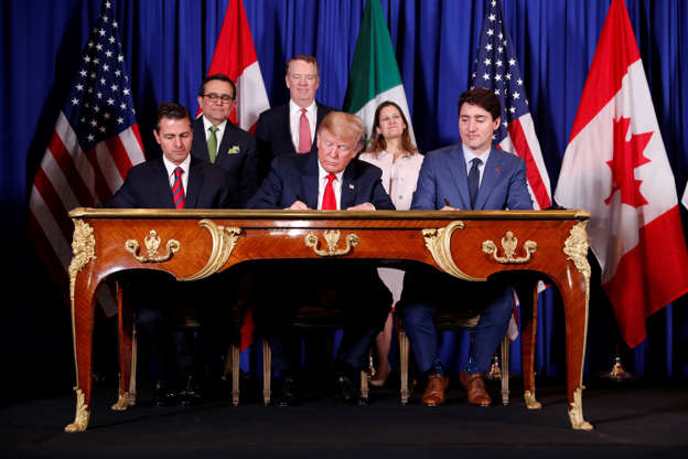 Diapositiva 23 de 55: U.S. President Donald Trump, Canada's Prime Minister Justin Trudeau and Mexico's President Enrique Pena Nieto attend the USMCA signing ceremony before the G20 leaders summit in Buenos Aires, Argentina November 30, 2018.