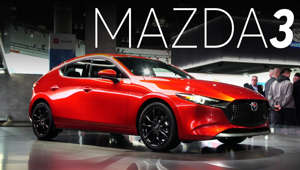 a black and red car parked on the side of a building: 2018 LA Auto Show: 2019 Mazda3