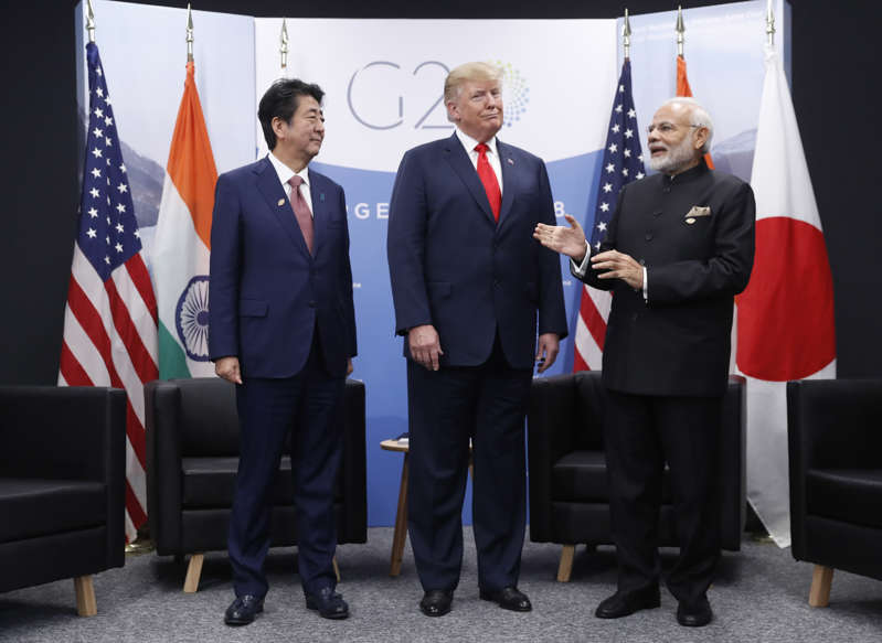President Donald Trump meets with India's Prime Minister Narendra Modi, right, and Japan's Prime Minister Shinzo Abe, Friday, Nov. 30, 2018 in Buenos Aires, Argentina. (AP Photo/Pablo Martinez Monsivais)