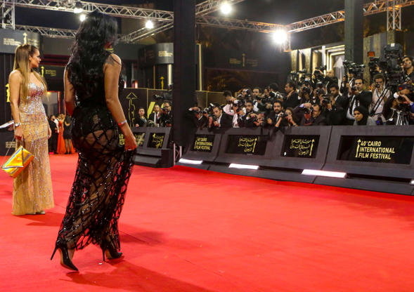 Egyptian actress Rania Youssef walks on the red carpet at the closing ceremony of the 40th edition of the Cairo International Film Festival (CIFF) at the Cairo Opera House in the Egyptian capital on November 29, 2018. - Youssef is to face trial in January 2019 for appearing at the closing ceremony of the Cairo International Film Festival wearing a revealing black lacy dress over a tight black body with her legs showing underneath, a judicial source said on December 1. This prompted two lawyers to lodge a suit against her accusing the actress of 'inciting debauchery', a charge that could land her in jail for up to five years if she is convicted. (Photo by PATRICK BAZ / Cairo International Film Festival / AFP) / RESTRICTED TO EDITORIAL USE - MANDATORY CREDIT 'AFP PHOTO / CAIRO INTERNATIONAL FILM FESTIVAL' - NO MARKETING - NO ADVERTISING CAMPAIGNS - DISTRIBUTED AS A SERVICE TO CLIENTS        (Photo credit should read PATRICK BAZ/AFP/Getty Images)