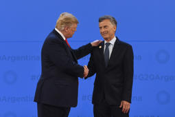 US President Donald Trump is welcomed by the President of Argentina Mauricio Macri .
