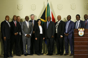 Newly appointed National Director of Public Prosecutions (NDPP) Advocate Shamila Batohi pose for a picture with and President Cyril Ramaphosa, members of the panel that conducted interviews and cabinet ministers during the announcement of her appointment at the Union Buildings on November 4, 2018 in Pretoria, South Africa. Batohi, who is the first woman to be appointed the National Director of Public Prosecutions (NDPP), will start her new role in February next year.