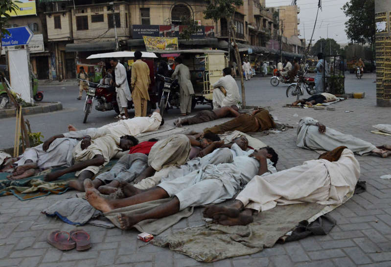 File photo of homeless people sleeping on footpath in Pakistan.