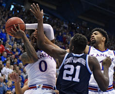 LAWRENCE, KANSAS - DECEMBER 15: Marcus Garrett #0 of the Kansas Jayhawks rebounds a ball against Dhamir Cosby-Roundtree #21 of the Villanova Wildcats in the first half at Allen Fieldhouse on December 15, 2018 in Lawrence, Kansas. (Photo by Ed Zurga/Getty Images)