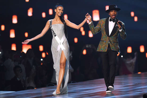 afcef7e87f098 ... Images Top three finalist Tamaryn Green (L) of South Africa hold hands  while US artist Ne-Yo performs on stage during the 2018 Miss Universe  Pageant in ...