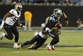 Carolina Panthers' Cam Newton (1) is sacked by New Orleans Saints' Demario Davis (56) in the first half of an NFL football game in Charlotte, N.C., Monday, Dec. 17, 2018. (AP Photo/Mike McCarn)