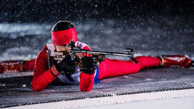 Slide 4 de 62: Biathlon training during winter blizzard.