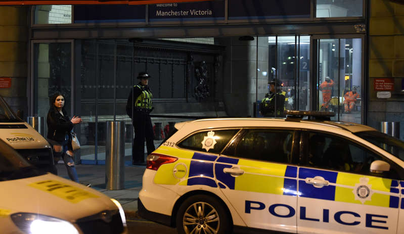 Police officers stand near a cordon at Manchester Victoria Station, in Manchester on January 1, 2019, following a stabbing on December 31, 2018. - A man, a woman and a police officer were being treated for knife injuries, police said Monday, after a stabbing at a railway station in the British city of Manchester. (Photo by Paul ELLIS / AFP)        (Photo credit should read PAUL ELLIS/AFP/Getty Images)