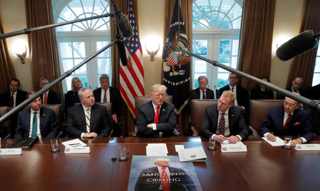 Slide 1 of 79: U.S. President Donald Trump attends a Cabinet meeting on day 12 of the partial U.S. government shutdown at the White House in Washington, U.S., January 2, 2019.