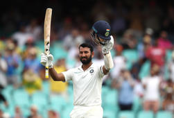 How has Pujara prospered in Australia?