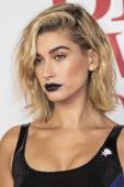 Model Hailey Baldwin poses for photographers upon arrival at the Brit Awards 2018 in London, Wednesday, Feb. 21, 2018. (Photo by Vianney Le Caer/Invision/AP)