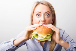 Woman eating burger