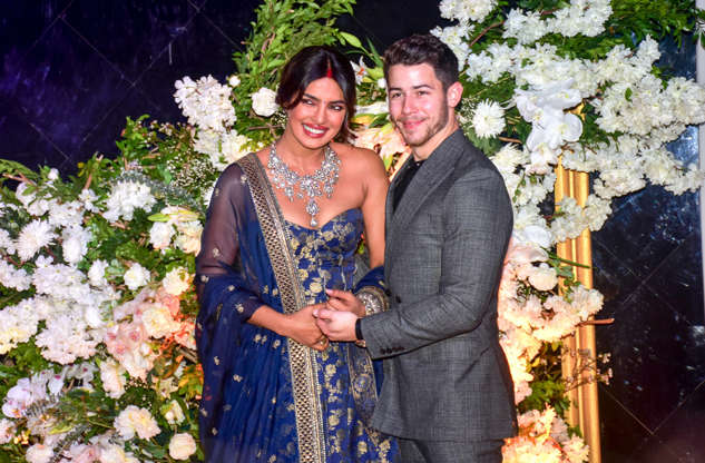 Slide 2 of 22: Indian actress Priyanka Chopra with her husband US musician Nick Jonas are seen during their wedding reception at the hotel JW Marriott in Mumbai.