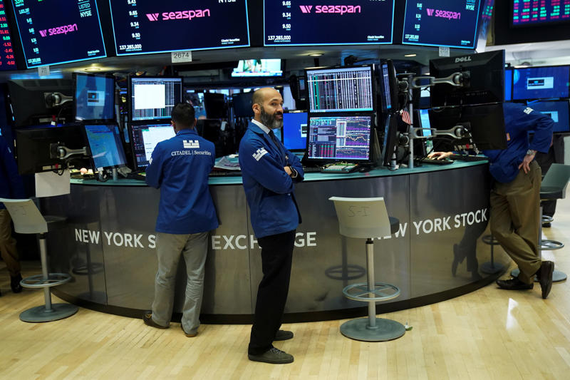 NEW YORK, NEW YORK - NOVEMBER 19: Traders and financial professionals work on the floor of the New York Stock Exchange (NYSE) at the closing bell, November 19, 2018 in New York City. Technology stocks continued to plunge on Monday, with Facebook and Apple down again as the Dow Jones Industrial average dropped nearly 400 points on the day. (Photo by Drew Angerer/Getty Images)