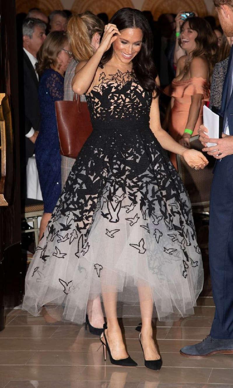 Meghan wearing a fairy tale embellished Oscar de la Renta gown in Sydney (Image: PA)