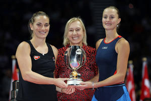 Kristina Mladenovic of France and Timea Babos of Hungary pose with the Martina Navratilova trophy and WTA legend Martina Navratilova