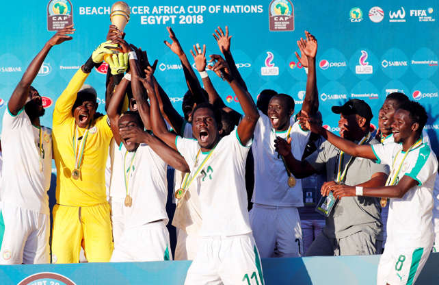 2018 Beach Soccer Africa Cup of Nations (AFCON) - Final - Senegal v Nigeria - Sharm el-Sheikh, Egypt - December 14, 2018. Players of Senegal celebrate with the trophy after winning the 2018 Beach Soccer Africa Cup of Nations (AFCON) against Nigeria.