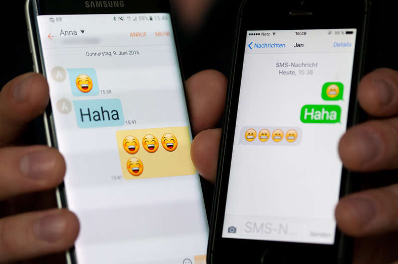 Laughing Smilies displays of Android smartphones (l) and an iPhone in Berlin, Germany, 09 June 2016. Monika Skolimowska/dpa | usage worldwide   (Photo by Monika Skolimowska/picture alliance via Getty Images)
