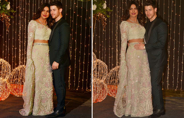 Slide 1 of 22: Priyanka Chopra and Nick Jonas pose for cameras at their reception in Mumbai.