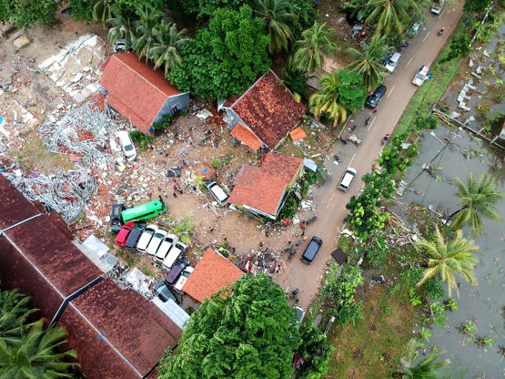 Slide 3 de 18: An aerial photo shows damaged buildings in Carita on December 23, 2018, after the area was hit by a tsunami on December 22 following an eruption of the Anak Krakatoa volcano.