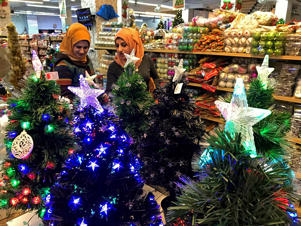 Iraqis shop for Christmas decorations in Baghdad, Iraq, Monday, Dec. 24, 2018.