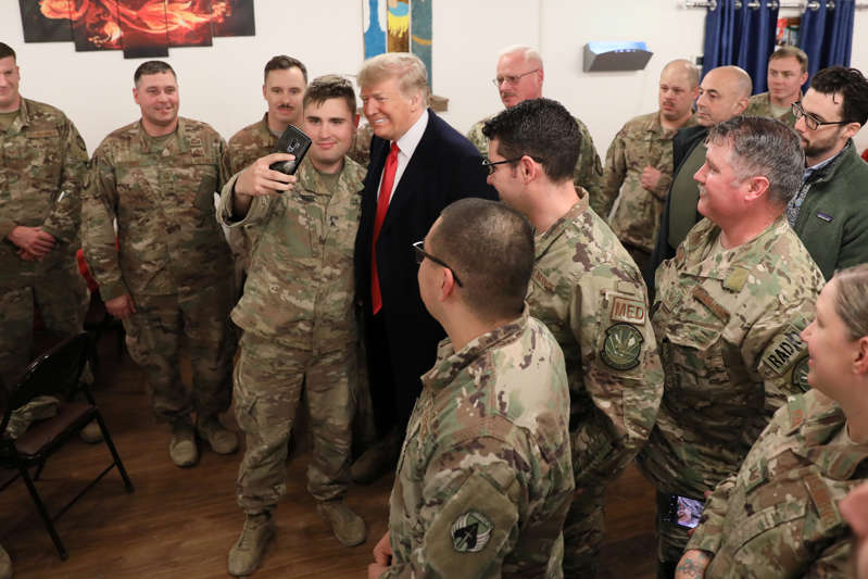 U.S. President Donald Trump and First Lady Melania Trump greet military personnel at the dining facility during an unannounced visit to Al Asad Air Base, Iraq December 26, 2018. REUTERS/Jonathan Ernst - RC1A8E1D11C0