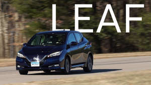 a person driving a car: 2018 Nissan Leaf Road Test