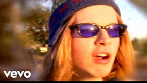 a person wearing sunglasses posing for the camera: Music video by Beck performing Loser. (C) 1993 Geffen Records