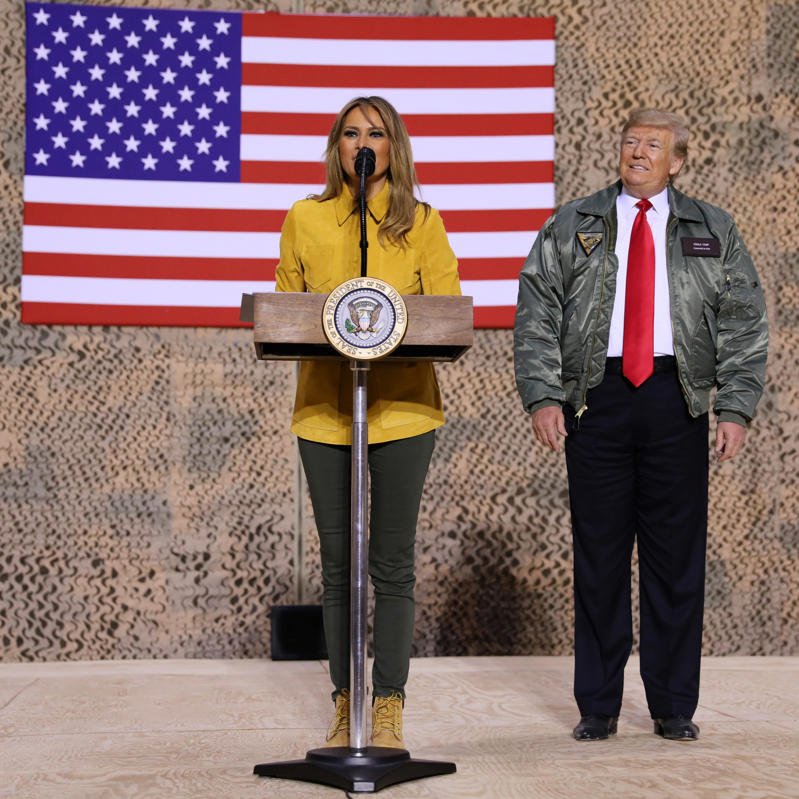U.S. first lady Melania Trump and President Donald Trump deliver remarks to U.S. troops in an unannounced visit to Al Asad Air Base, Iraq, December 26, 2018. REUTERS/Jonathan Ernst