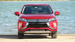 a red car parked next to a body of water: 2019 Mitsubishi Eclipse Cross SE: Review