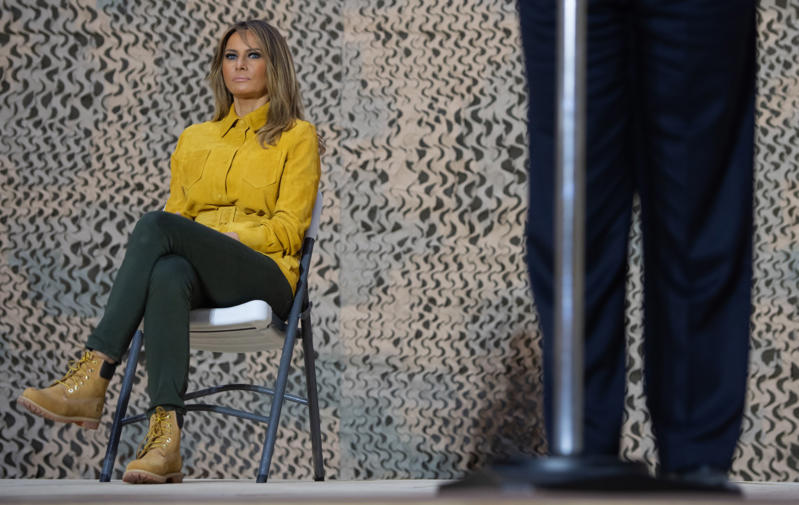 First Lady Melania Trump sits onstage as US President Donald Trump speaks to members of the US military during an unannounced trip to Al Asad Air Base in Iraq on December 26, 2018. - President Donald Trump arrived in Iraq on his first visit to US troops deployed in a war zone since his election two years ago (Photo by SAUL LOEB / AFP)        (Photo credit should read SAUL LOEB/AFP/Getty Images)